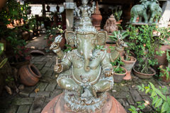 Lord Ganesh - Hindu God of Prosperity in the garden. Stock Photo