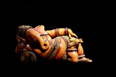 Lord ganesha. Lord ganesh taking rest against a black background Stock Photo