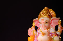 Lord Ganesha on a Dark background. Ganesha is one of the best-known and most widely worshipped deities in the Hindu pantheon. His image is found throughout India Stock Photography
