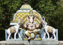 Lord Ganesha flanked by two elephants. Stock Images