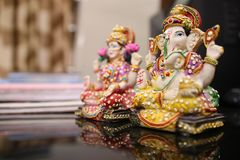 Lord Ganesha and Goddess Lakshmi idol. Lord Ganesha and Goddess Lakshmi are worshipped during Diwali festival. Diwali or Deepawali is a festival of light and Royalty Free Stock Photos