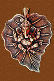 Lord Ganesha on leaf made from clay Stock Photos
