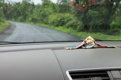 Lord Ganesha no dashbord do carro - Índia Imagem de Stock