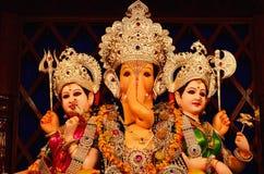 Lord Ganesha with Rddhi and Siddhi, Nagnathpar Sarvajanik Ganapati Mandal Trust, Pune, Maharashtra, India. Lord Ganesha with Rddhi and dhi, Nagnathpar Sarvajanik stock photo