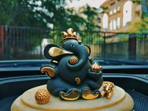 Lord ganesha. Ganesha sitting with his mouse , having a sweet in hand Stock Photos