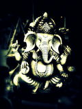 Lord Ganesha. The Lord of Success. The son of Shiva and Parvati, Ganesha has an elephantine countenance with a curved trunk and big ears, and a huge pot-bellied Royalty Free Stock Photography
