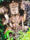 Lord Hanuman. A beautifully carved wooden idol of Lord Hanuman, in the woods Stock Images