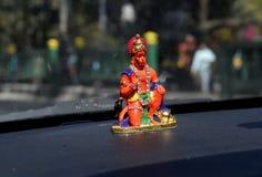 Lord Hanuman idol on a car dashboard royalty free stock images