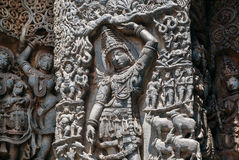 Lord Krishna lifting Mt. Govardhan on relief of the 12th century ornate Hoysaleshwara temple in Halebidu, India. Royalty Free Stock Photo