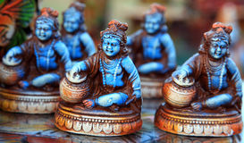 Lord krishna poses. Lord krishna statues for sale in decoration shop Royalty Free Stock Image
