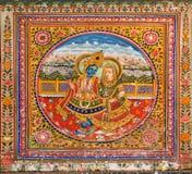 Lord Krishna que toca la flauta para su esposa en un fresco Imagenes de archivo