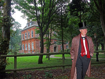 Lord of the manor. Photo of monocled Lord Mulholland posing outside his country manor estate in Kent dressed in traditional landed gentry attire with top hat and Stock Photos