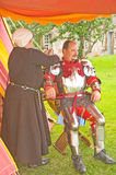 Lord Marr putting on armor. Stock Photos