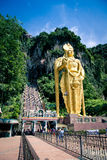 Lord Murugan statue in front the entrance of holy Batu Caves on November 24, 2012. Royalty Free Stock Photography