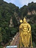 Lord Murugan statyBatu grottor Arkivbild