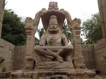 Lord Narasimha. A huge stone marvel at Hampi, the capital of then Vijayanagara empire royalty free stock photography