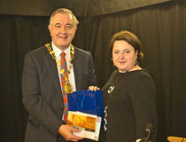 Lord Provost of Inverness. Joanna Napiorkowska giving a small present to the Provost of Inverness, Alex Graham at the end of the 60 th anniversary celebration of Stock Image