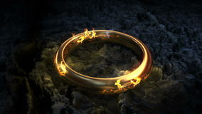 Lord of the rings.  Gold ring. Text appears on the ring. stock video