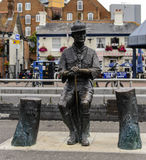 Lord Robert Baden Powel Bronze Statue Poole Quay. A memorial to Lord Baden Powell who organised the first Boy Scout Camp on Brownsea Island in Poole Harbour Royalty Free Stock Photos