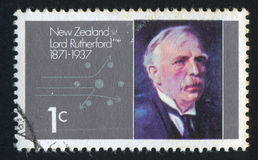 Lord Rutherford. NEW ZEALAND - CIRCA 1971: stamp printed by New Zealand, shows Lord Rutherford and Alpha Particles Passing Atomic Nucleus, circa 1971 Stock Photography