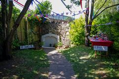 Lord Sandy`s Spout, Malvern, Worcestershire. Lord Sandy`s Spout, Malvern, Worcestershire, at well-dressing time. Decorated with bunting and ribbons Royalty Free Stock Photo