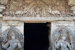 Lord Shiva dancing and door keepers to Shiva carved at the entrance of Hoysaleshwara temple at Halebidu. Hassan district, Karnataka state, India, Asia Royalty Free Stock Photo