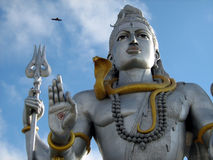 Lord Shiva idol close up. Low angle view of statue of Hindu God Lord Shiva with serpent wrapped around neck Stock Image
