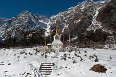 Lord Shiva Temple at Yumthang. An old temple of Lord Shiva is in the lap of snowy peaks and rhododendron trees at Yumthang valley, from where one can have a Stock Photography