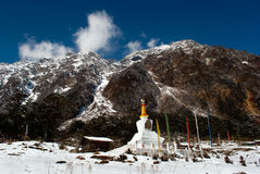 Lord Shiva Temple at Yumthang. An old temple of Lord Shiva is in the lap of snowy peaks and rhododendron trees at Yumthang valley, from where one can have a Royalty Free Stock Image