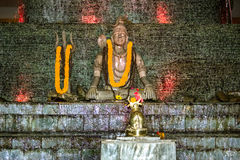 Lord Shiva under running water Royalty Free Stock Image