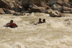Lore seti  rafting time local boys are having fun. This boys are Tubing in the olre seti river it was so fun look`s like royalty free stock photos