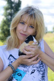 Woman with in arms rabbit. Loredana cannata with rabbit in his arms in Rome Stock Images