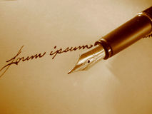 Lorem Ipsum. Fountain Pen with the text Lorem ipsum. Sepia Monochrome If you can, please leave a comment about what you are going to use this image for. It'll Stock Photo