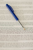 Lorem Ipsum with pen. Parts of the text are blurred royalty free stock photo