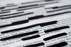 Lorem Ipsum text that has been redacted. Printed page royalty free stock photo