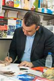 Lorenzo Silva signs his book to. A reader at the book fair in Madrid on January 10, 2011 Royalty Free Stock Photography