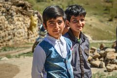 Iranian boys on wedding ceremony in the village. Lorestan Province. Iran. Lorestan Province, Iran - April 1, 2018: Iranian young boys on wedding ceremony in the stock images
