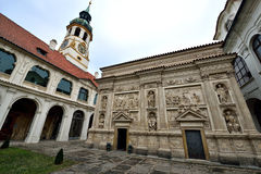 Loreta Prague. Loreta is a large pilgrimage destination in Hradčany, a district of Prague, Czech Republic. It consists of a cloister, the church of the Lord's Stock Photos