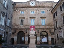 Loreto medieval town in central Italy. The medieval building of the municipality and the statue of Garibaldi in the city of Loreto. Marche Region, central Italy stock photo