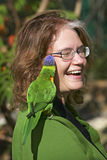 Lorikeet on woman Royalty Free Stock Image