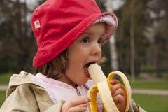 Loro ragazza della banana Fotografie Stock