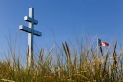 Lorraine cross at Juno Beach. The Lorraine cross at Juno Beach, France royalty free stock image