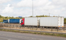Lorries on the British motorway. Busy British motorway full of lorries stock photo