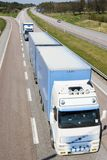 Lorries on highway. Two lorries on highway through countryside stock photo