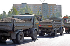 Lorries loaded by hot asphalt Royalty Free Stock Image