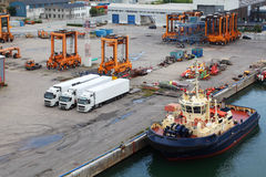 Lorries and loaders stand in port Stock Photography