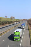 Lorries on M6 motorway in countryside near Borwick Stock Image
