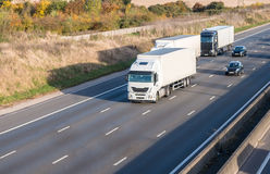 Lorries on the motorway. Three lorries in motion on the motorway stock photos