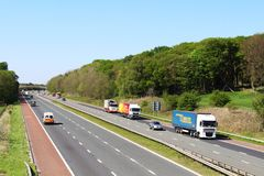 Lorries and other vehicles, motorway on sunny day Royalty Free Stock Photo