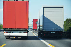 Lorries overtaking one another Stock Photos